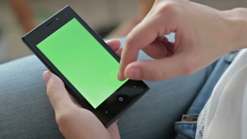 Woman hands touching and scrolling smartphone.green screen display #12004040