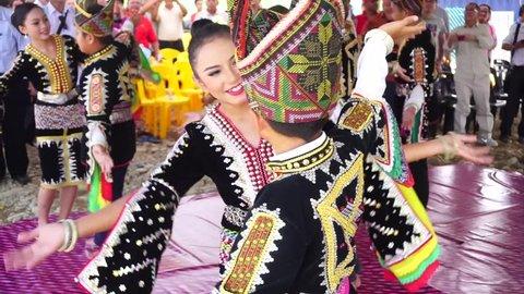 Kota Belud Sabah Malaysia - Circa October 2015 : A group of Dusun Tindal performing traditional dance called Pakudiding Sumazau during event in Kota Belud Sabah Malaysia.