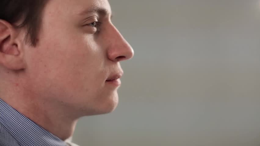 Man uses mint breath freshener, spray