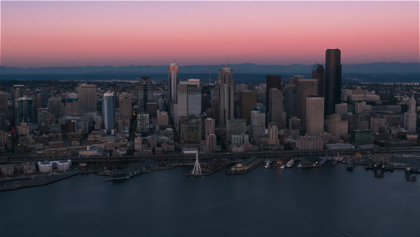 Dusk aerial of Seattle from Elliott Bay - Seattle, WA. September 11, 2015 Early evening low altitude view of Seattle's skyscrapers and financial district.
