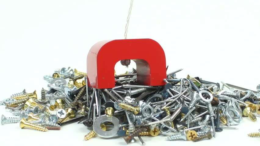 Red horseshoe magnet lifts large clump of nails, screws and washers. 1080p