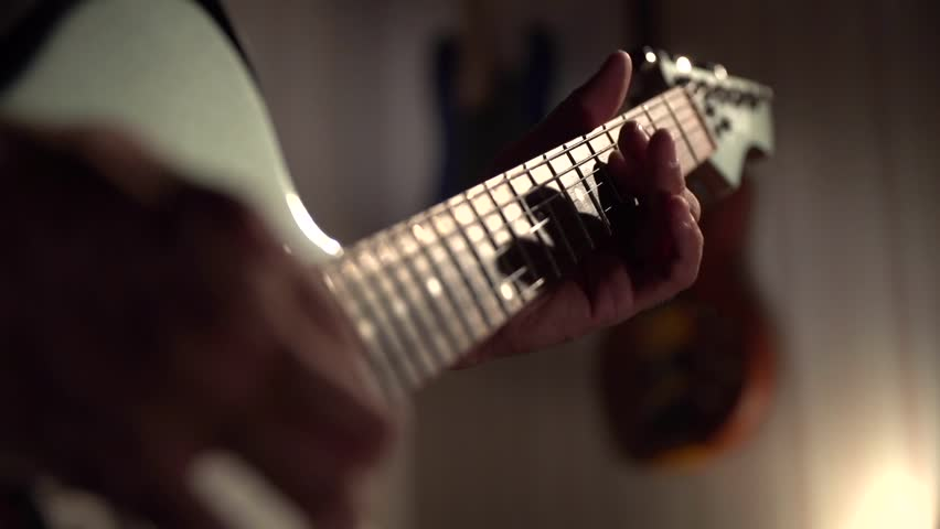 Hands of the guitarist are played solo on an electric guitar in dark studio | Shutterstock HD Video #12113600