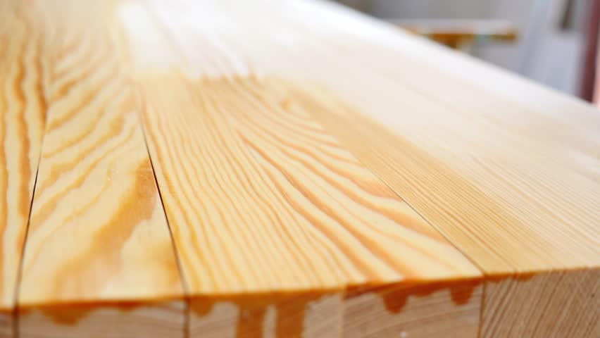 4k00:16Low Angle And Side Shot Of A Person Applying A Wood Protection  Liquid To Some Planks.