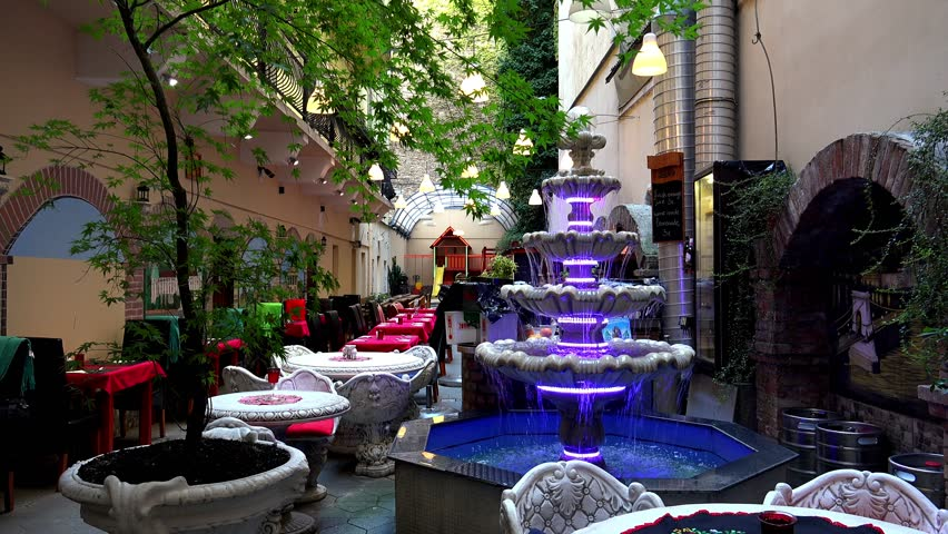 budapest hungary summer 2015 a cozy cafe with a fountain shot - Violet Cafe 2015