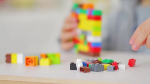 Orvieto, Italy - March 9th 2015: Close up of Lego bricks. Child playing in background. Lego is a popular line of construction toys manufactured by the Lego Group