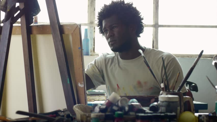 Young black people painting for hobbies. Proud african american man working as professional painter, skillful Cuban artist in art studio near table full of equipment, tools, canvas and paint   Shutterstock HD Video #12167255