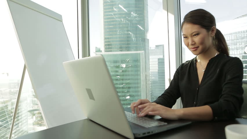 Young Asian Business woman at office with laptop, prints the text, Dolly shot | Shutterstock HD Video #12187130