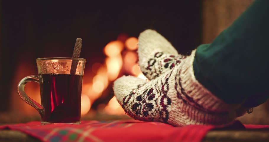 Woman Feet In Woollen Socks By The Cozy Fireplace, 4K. Stabilized ...