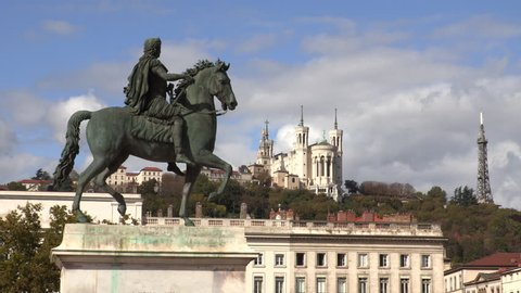 4K Timelapse of Louis XVI statue and Basilique Fourviere on a background, Lyon, France.