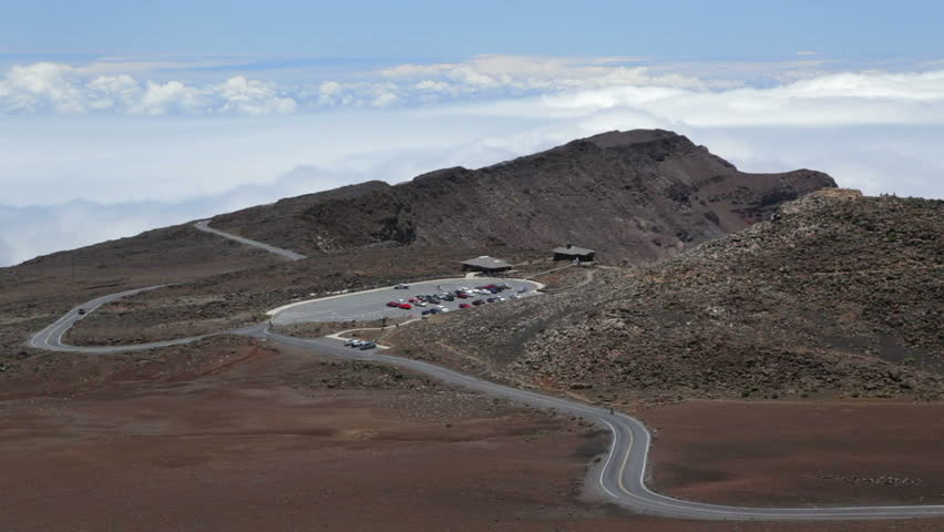 Haleakala crater road with the upper visitors center and parking haleakala crater road with the upper visitors center and parking lot in the distance panning to a view into haleakala crater stock footage video 12229910 publicscrutiny Image collections