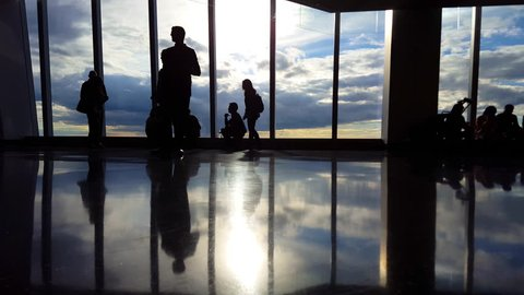 People at Airport Terminal Silhouette of travelers Waiting to board flight 4K