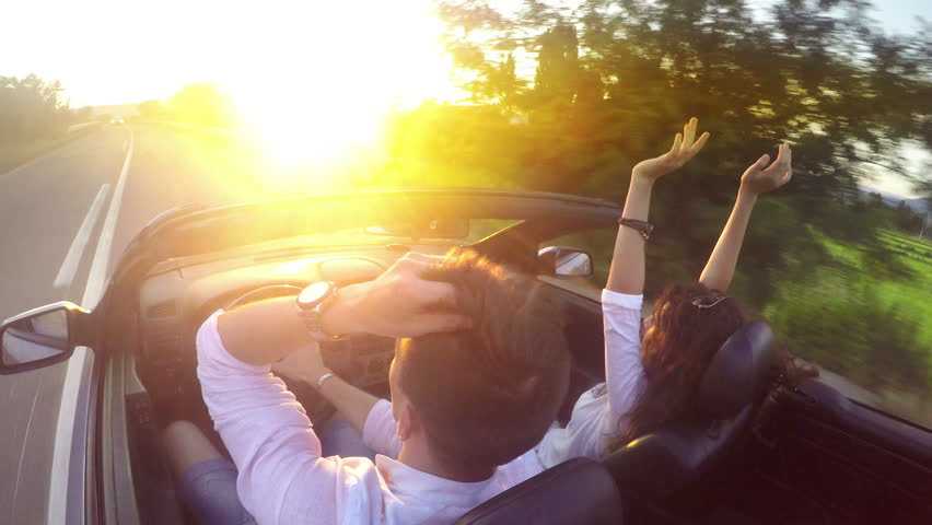 Woman expresses joy, Convertible, Couple, Women, Driving, Car, UHD 4K stock footage #12258170