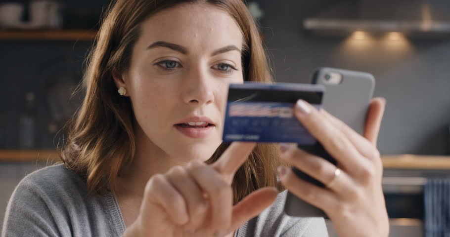 Beautiful woman online banking using smartphone shopping online with credit card at home lifestyle | Shutterstock Video #12266270