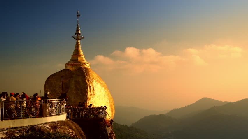 Burmese people praying near Golden Rock | shuttestock