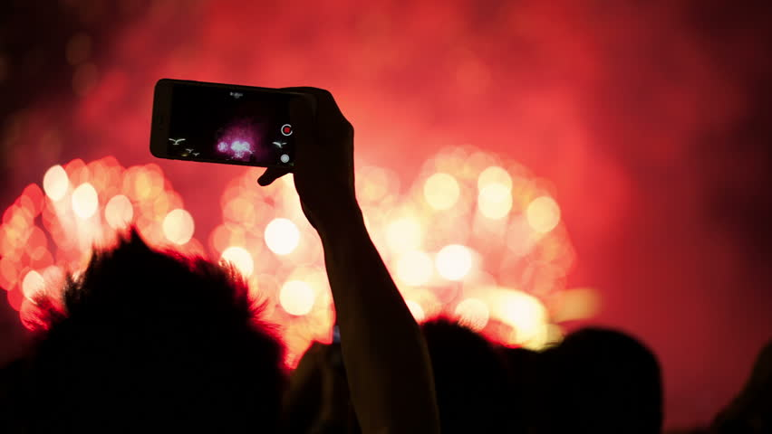 Firework, public, smartphones. Holiday backgrounds. Fireworks in the sky celebrating lunar new year... >>> Please search more: