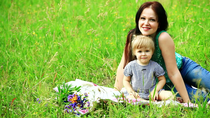 Mother and baby lying in the meadow  | Shutterstock HD Video #1231660