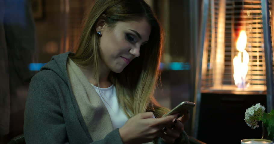 Beautiful woman texting on smartphone in the city | Shutterstock HD Video #12324020