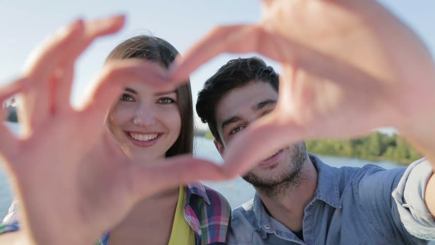 Lovers Making A Heart Shape With Hands. They Are Looking At The Camera And  Show Heart. Concepts About Love, Dating, Date, Wedding, ...