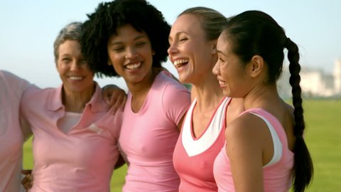 Smiling women wearing pink for breast cancer in parkland