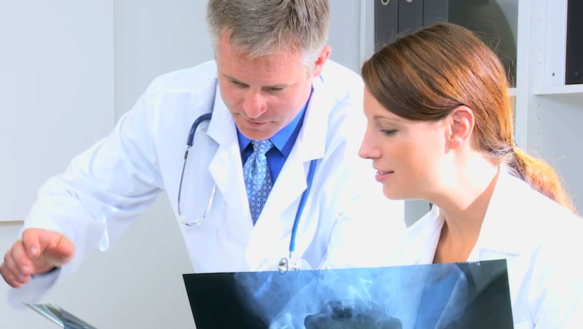 Hospital Consultants Comparing Patient X-ray Film With Medical ...