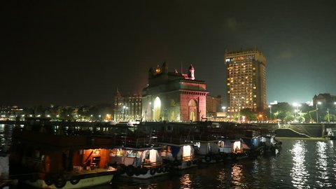Mumbai, India: September 8,2015: 4K footage of Gateway of India and Hotel Taj Mahal Palace at night, shot from a Ferry boat on September 8, 2015.