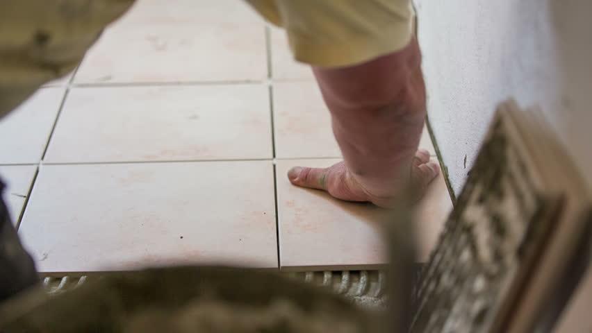 Taking up floor tiles