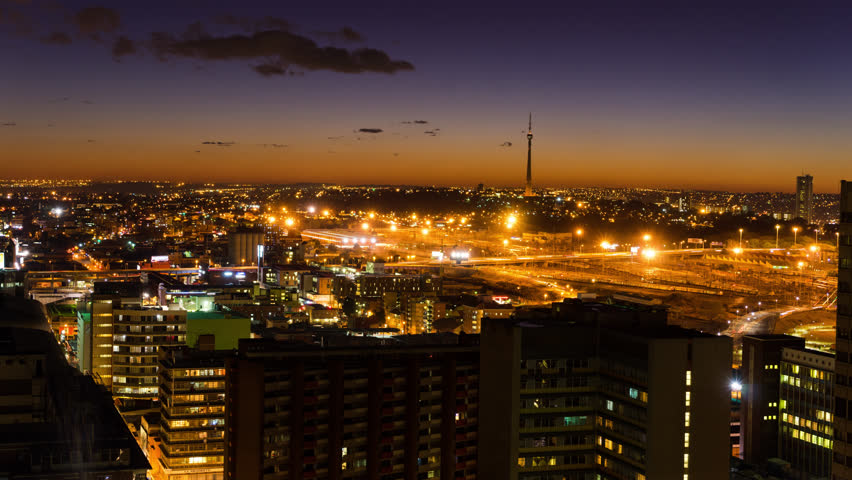A night timelapse of the city centre of Johannesburg (CBD) at nightfall in peak traffic showing the Sentech Tower in the Braamfontein, New Town areaJohannesburg, Gauteng, South Africa - 25/07/2015)