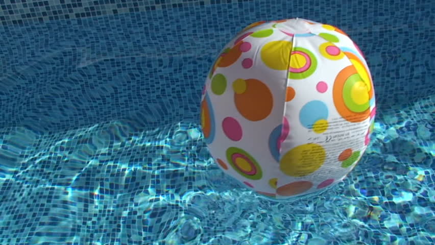 Swimming Pool Beach Ball Background dolphins swimming underwater in pool/abstract water surface