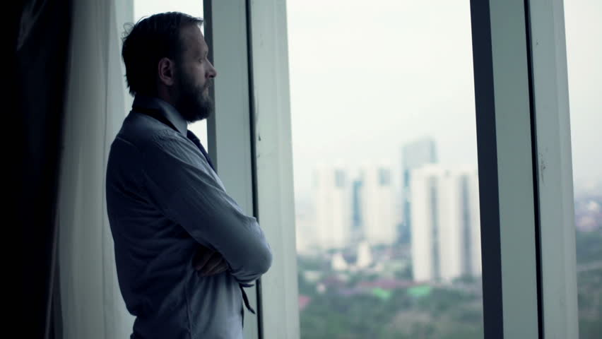 Young businessman admire view from window  | Shutterstock HD Video #12412973