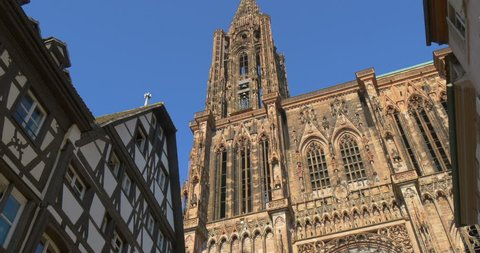 Pan tilt up motion video of the Strasbourg Cathedral church (Cathédrale Notre-Dame) of of Our Lady in Alsace region of France, Europe. Old town gothic architecture, catholic religion, travel landmark