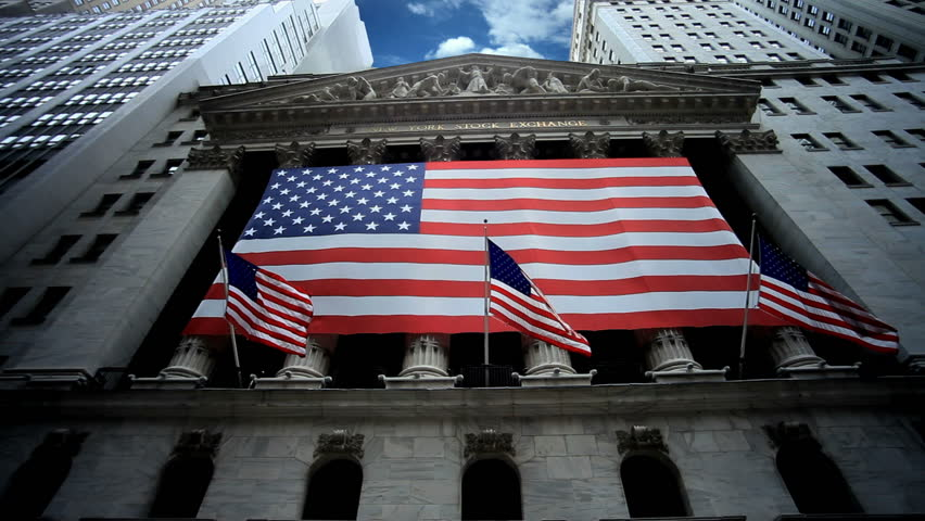 New York Stock Exchange - Beautiful Timelapse of NYSE in Lower Manhattan NYC USA with American Flags Waving and Blue Sky Overhead