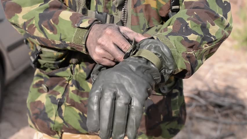 Man in military uniform dress gray leather gloves on sunny  day.Close-up Soldier wears leather gloves.Close-up 7d2083787b7