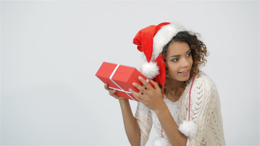 Pretty Girl Shaking Christmas Gift Stock Footage Video 100