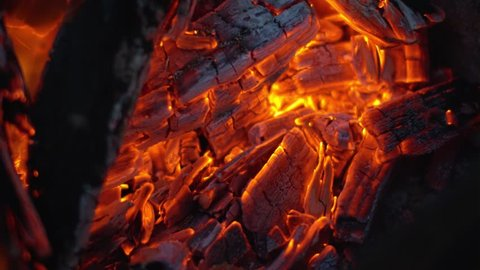 Fanning campfire embers close up