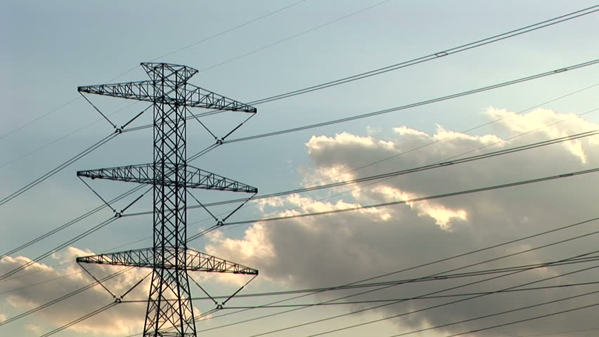 time lapse of clouds moving across a large power tower