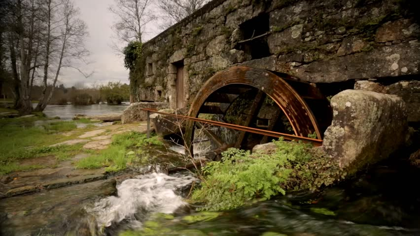 Cinemagraph Loop - An old drain from an old house sits on sinking land - motion photo