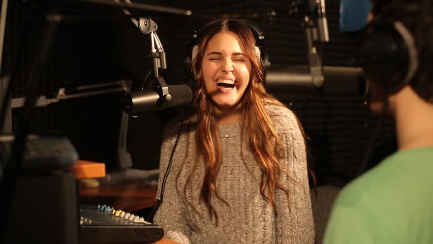 Cute girl talking with a guest DJ in the studio | Shutterstock HD Video #12541700