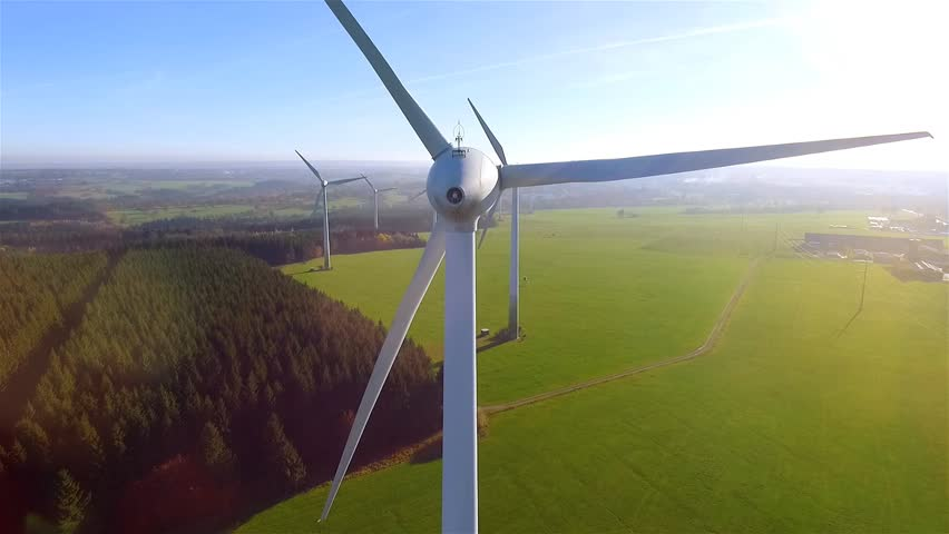 AERIAL 4K / Ultra HD - Birds eye view on Wind Power, Turbine, Windmill, Energy Production - Clean and Renewable Energy