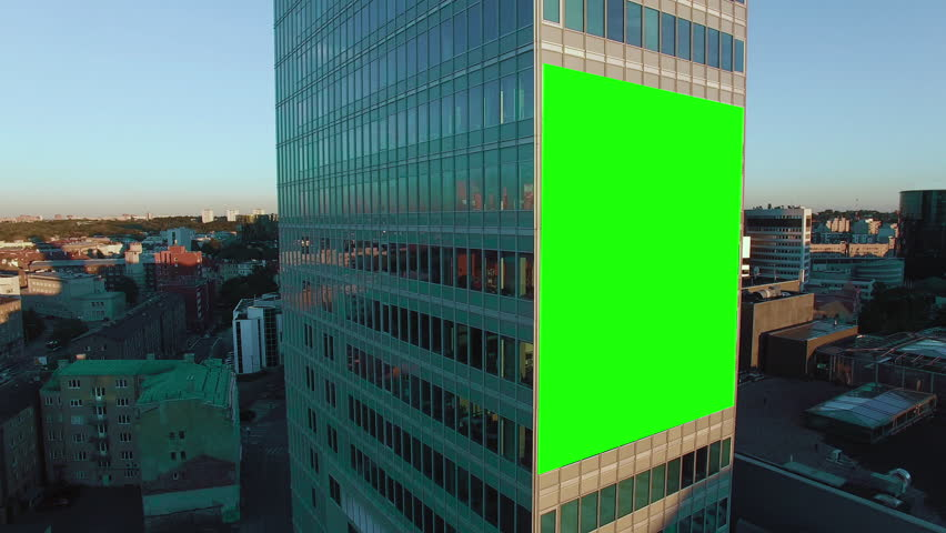 Aerial Orbit Shot of Glass Office Building With Green Screen Mock-up of Billboard in Business District. | Shutterstock HD Video #12581273