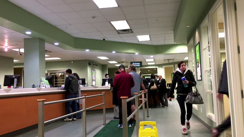Coquitlam, BC, Canada - November 02, 2015 : People at service counter talking to the teller inside TD Bank with 4k resolution