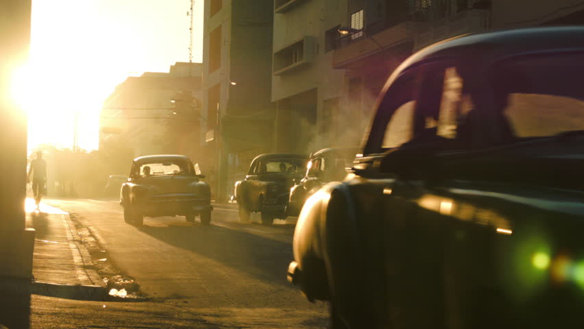 Row of classic cars in traffic during the sunset glow in Havana   Shutterstock HD Video #12619322