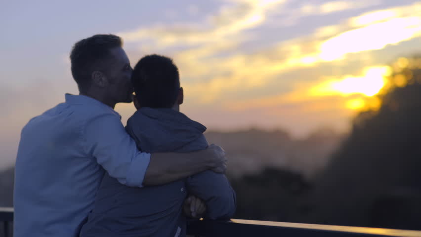 Gay Couple Watch Sunset From Scenic Overlook In San Francisco
