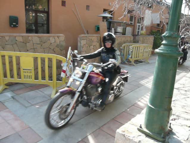 Convoy of motorbikes leaving a Harley Davidson exhibition