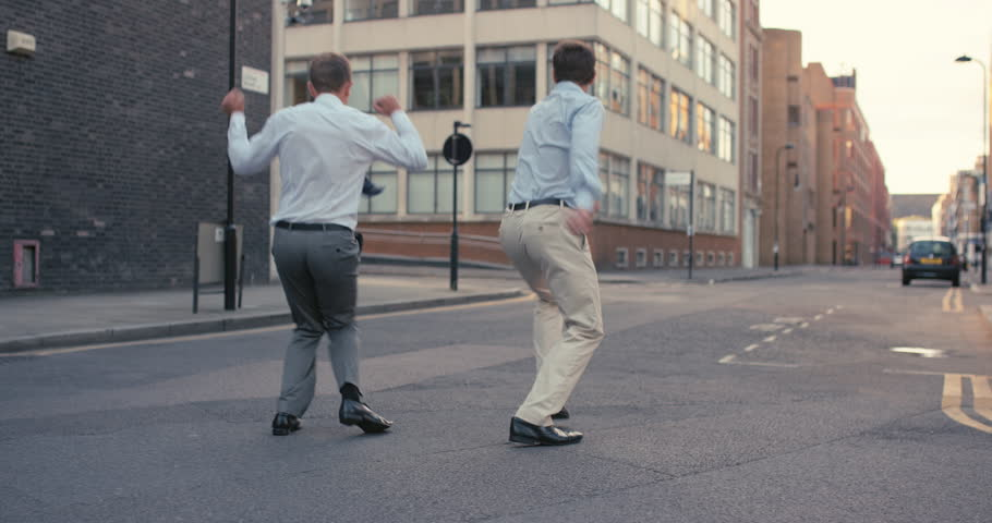 Businessman dancing crazy happy funky caucasian street dancer freestyle in the city