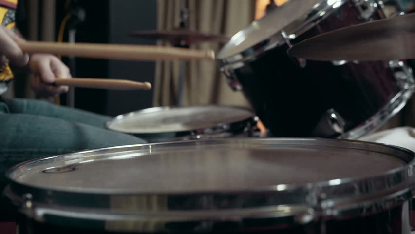 Musician playing drums at studio, close up, slow motion #12660350