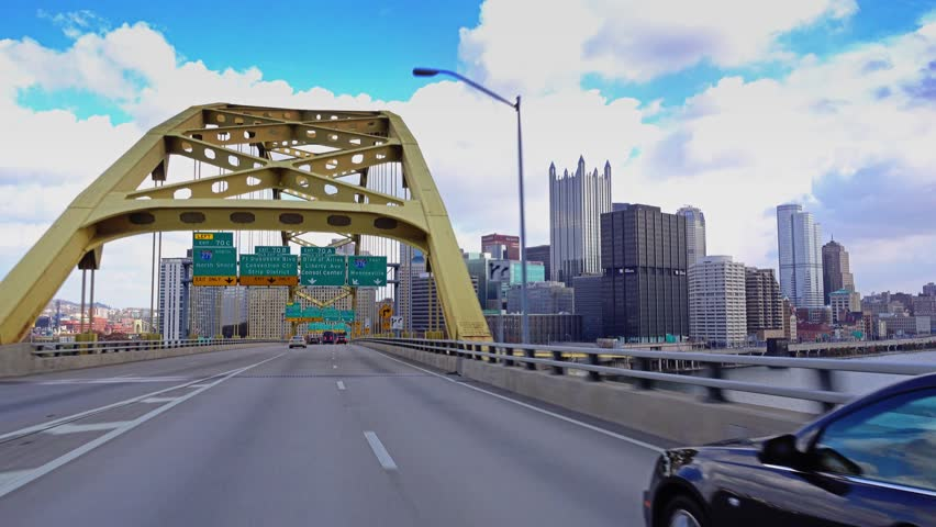 PITTSBURGH, PA - Circa November, 2015 - A view of Pittsburgh as you emerge from the Fort Pitt Tunnels. Shot with a gimbal for steady motion.