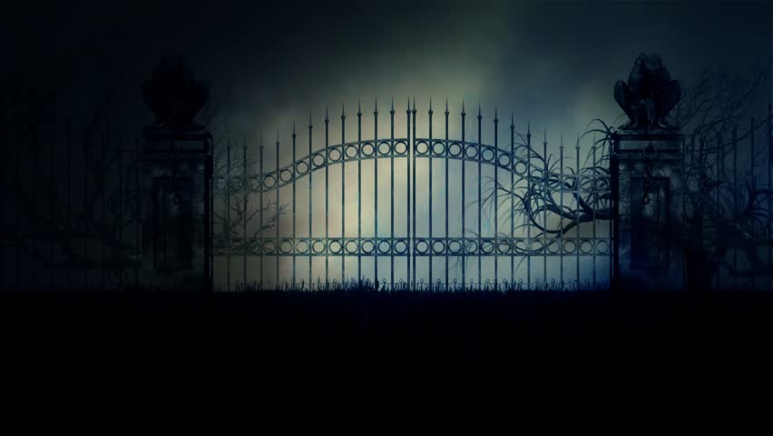 Scary and Spooky Cemetery Gate in a Stormy Rainy Night Under a Thunderstorm