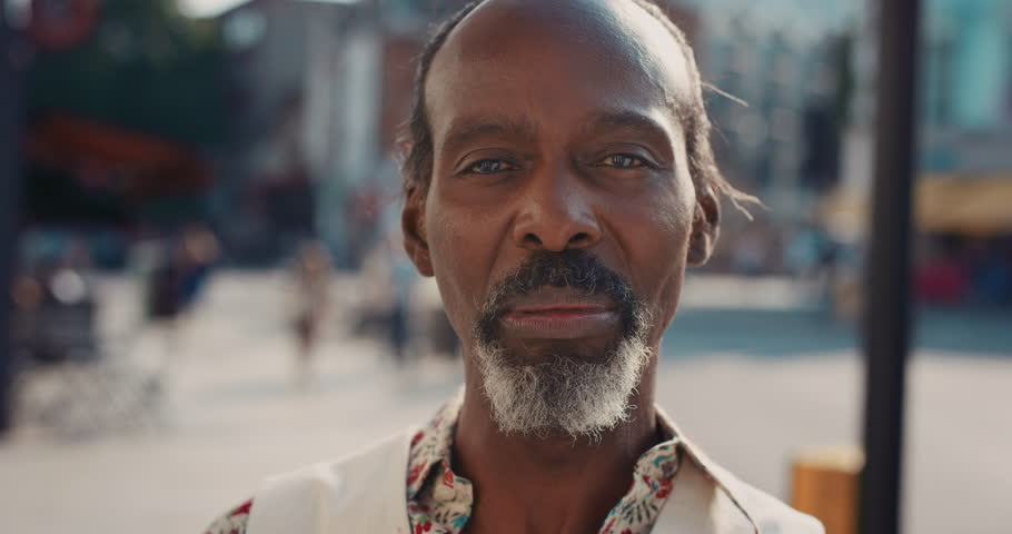Slow Motion Portrait of happy mature african american man smiling in city real people series | Shutterstock HD Video #12665654