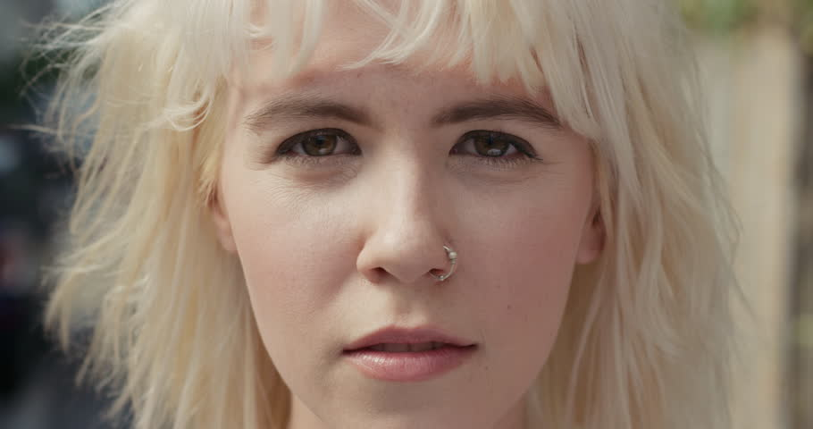 Close up Slow Motion Portrait of beautiful caucasian woman wearing nose ring in the city real people series #12665918