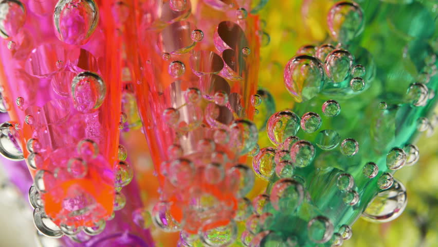 Soda water bubbles. Sparkling bubbles rising in a glass of clean water. Macro close-up 4K UHD 2160p footage.   Shutterstock HD Video #12669650